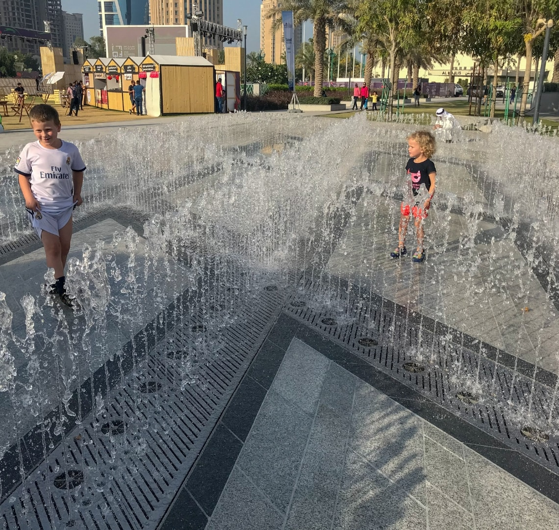 11 incredible things to do in Qatar - the Things playing in some outdoor water fountains