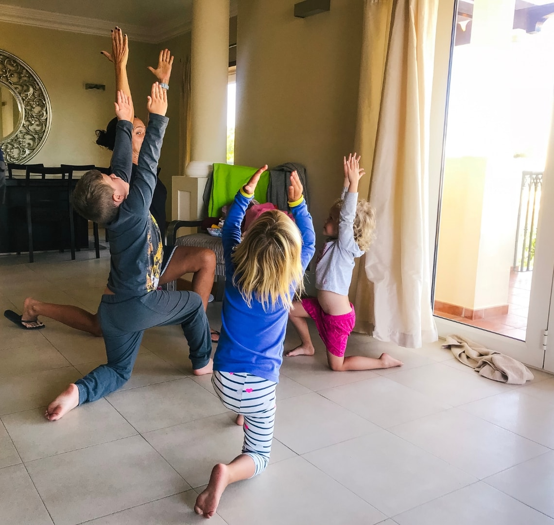 Cures For Jet Lag - The Things with their cousin and aunt doing bedtime yoga in our villa in Portugal