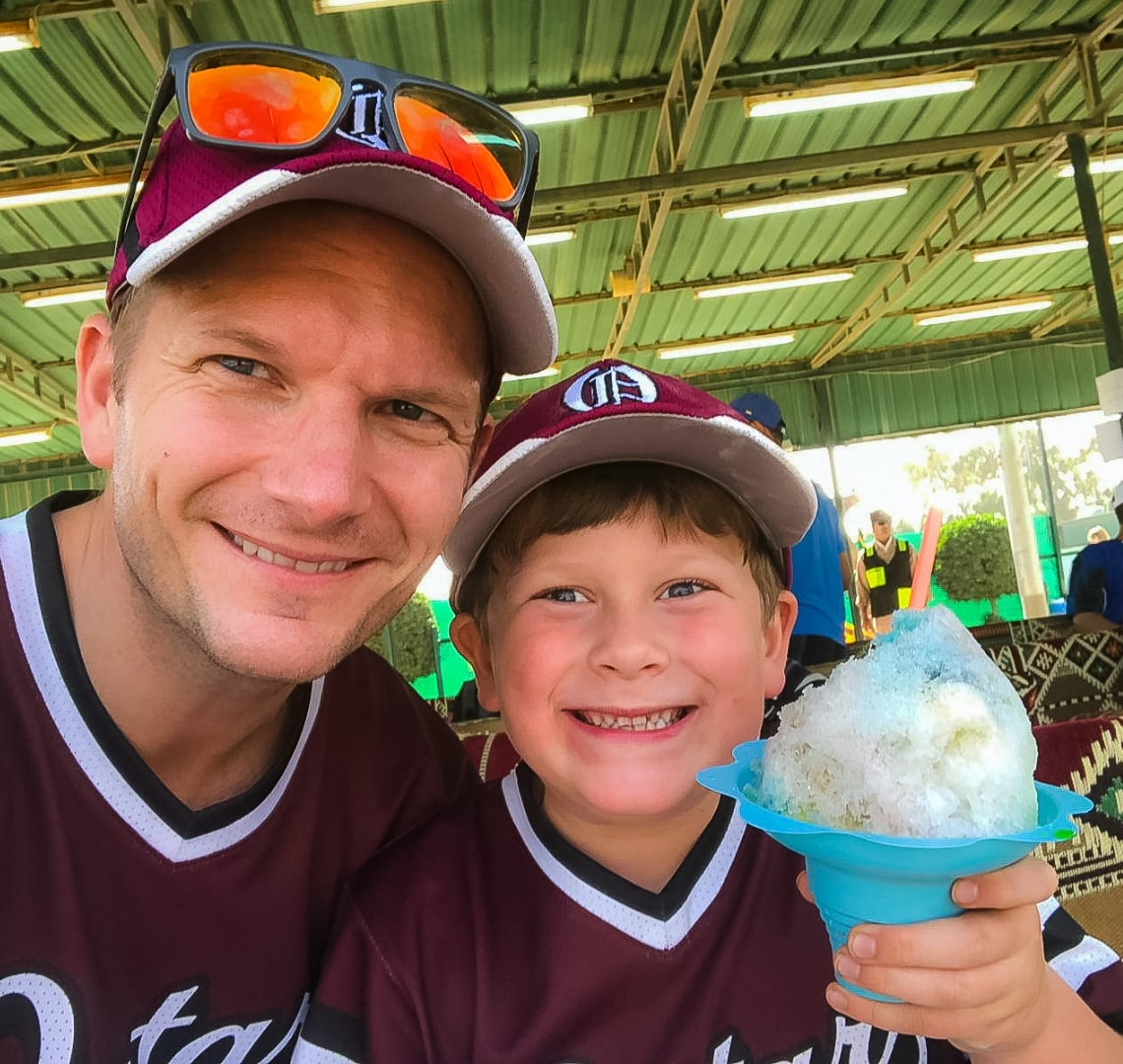 Baseball Mom - Mr Wanderlust and Thing 1 with an enormous sno cone beaming from ear to ear!