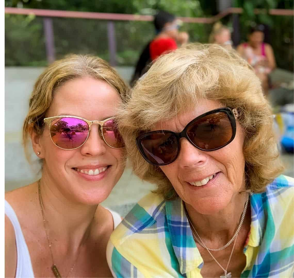 Me and Granny Wanderlust selfie in Singapore, We are both wearing sunglasses, My hair is tied back as usual. She is wearing a yellow and blue checked shirt and I am wearing a white tank top.