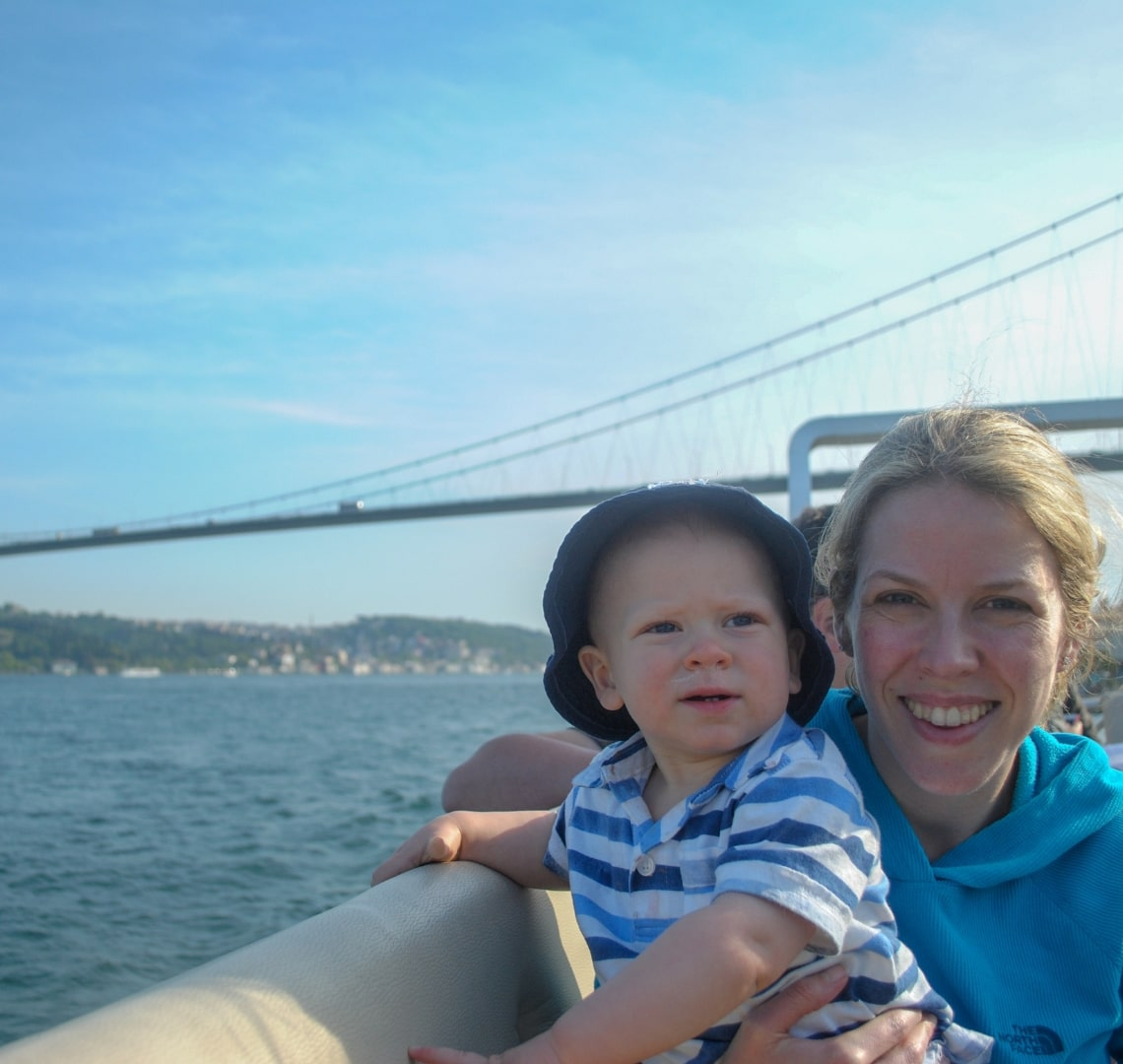Best family holiday destinations - me and Thing 1 as a toddler on a boat in the middle of the Bosphorus