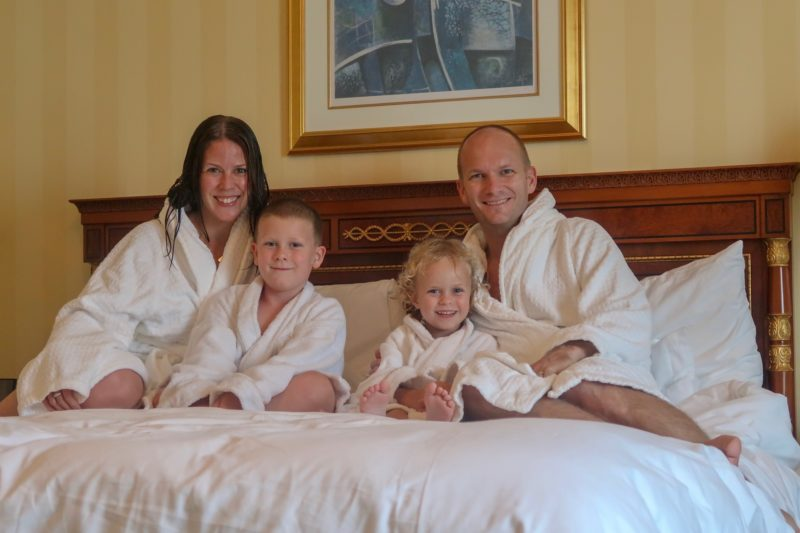 Four Seasons Doha - Wanderlust family photo in our bathrobes on the bed