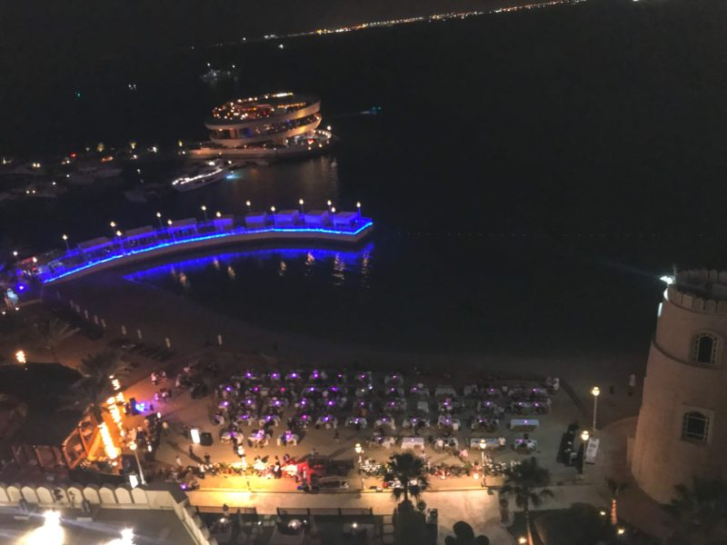 Four Seasons Doha - view from our room across the Barefoot Beach BBQ night, The Pier and Nobu