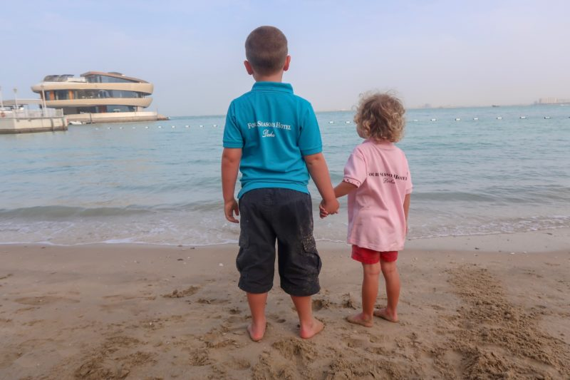 Four Seasons Doha - the Things looking out over the bay in their Four Seasons branded shirts