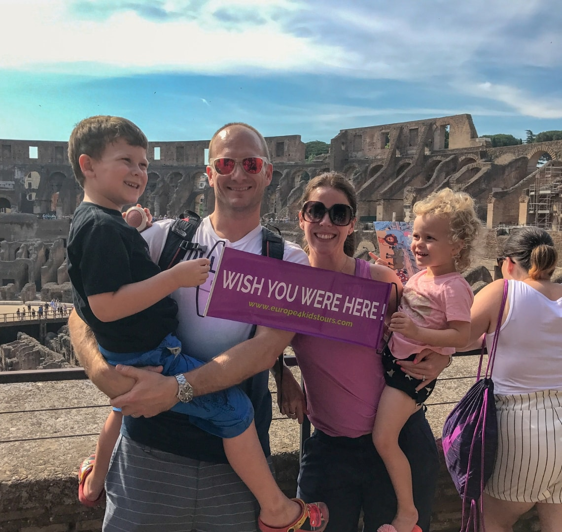 How to have an epic family holiday - Wanderlust family photo in coliseum Rome