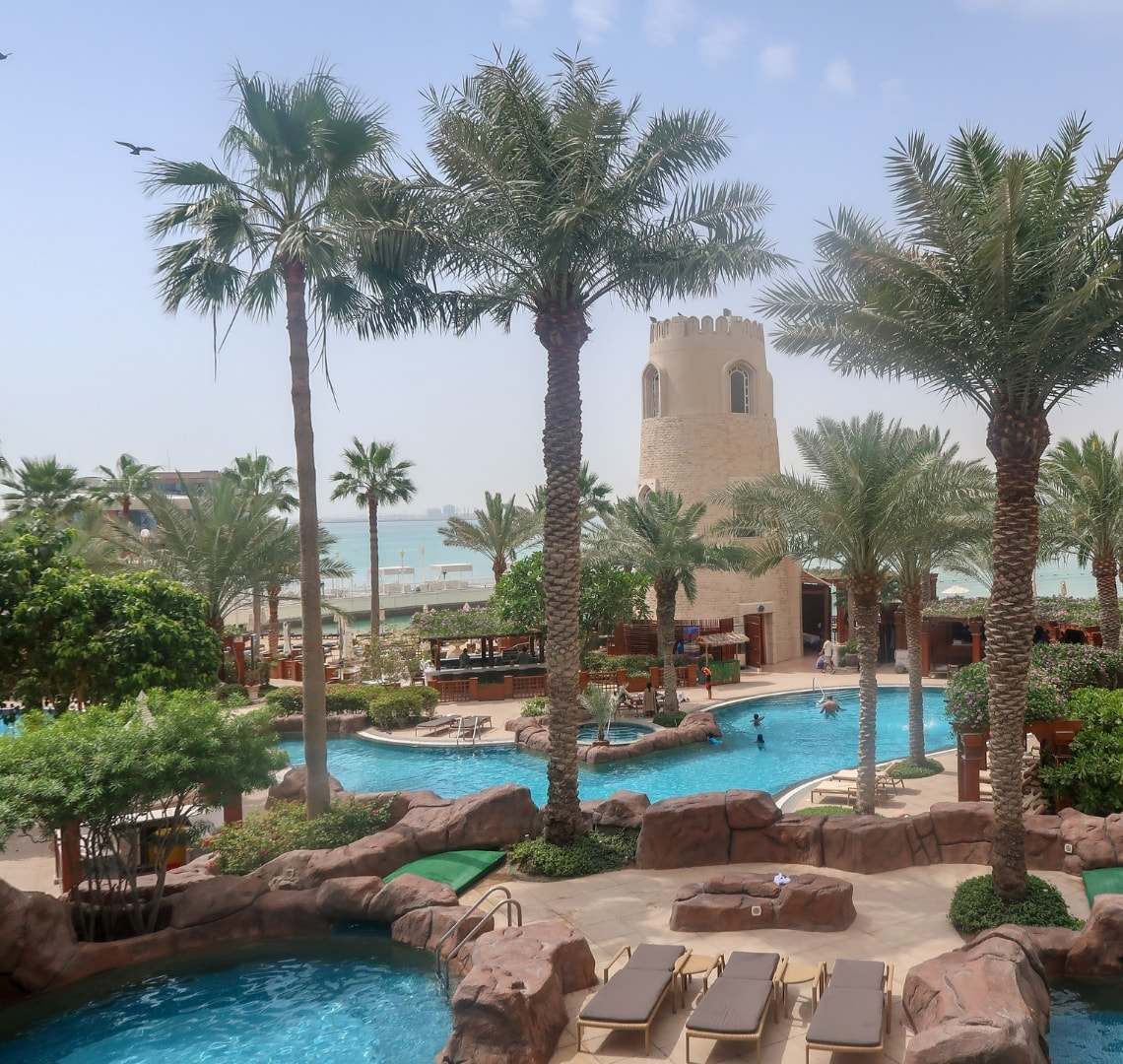 How to have an epic family holiday - pool and outside area at Four Seasons Doha