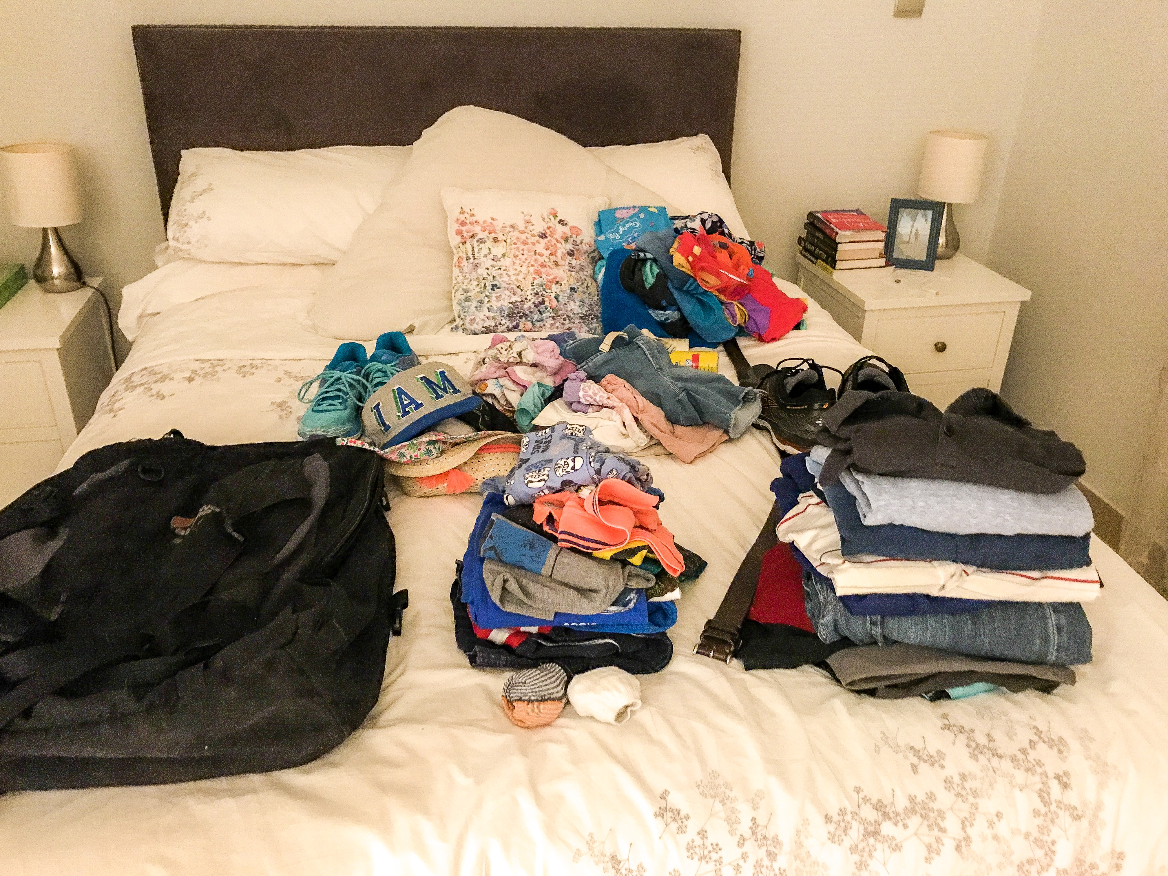 Packing laid out on bed