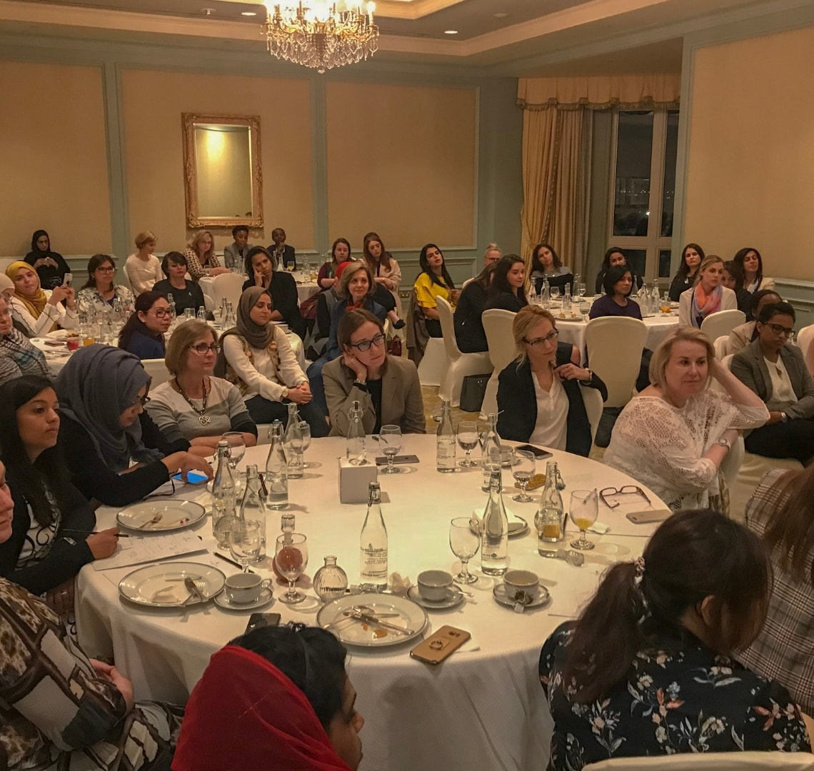 Tables of women at a Doha networking event