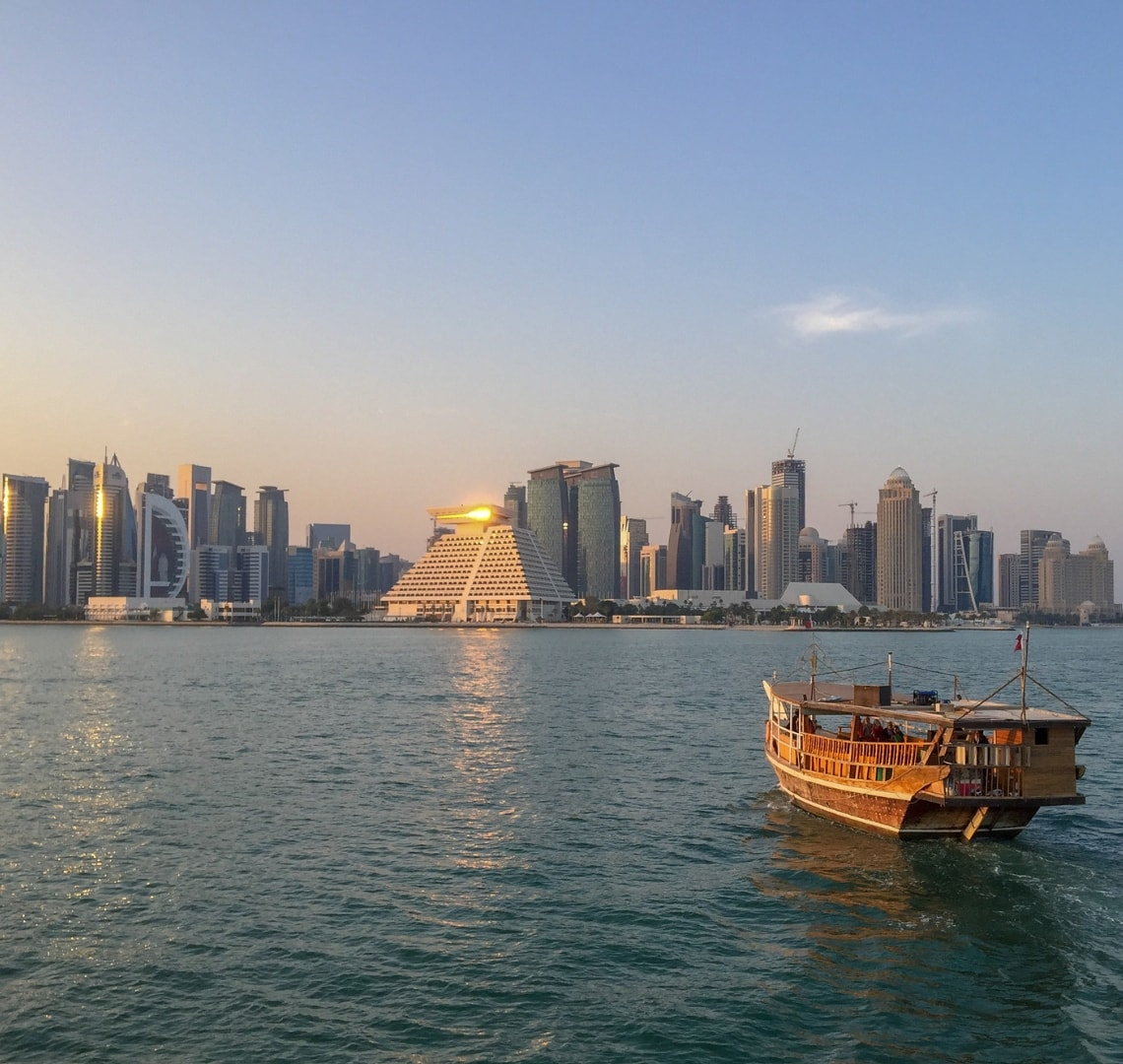 Normal Expat Christmas - View of the Doha skyline and a dhow boat from the sea