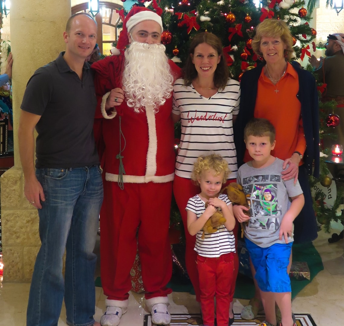 Normal Expat Christmas - Wanderlust family with Father Christmas in front of a Christmas tree