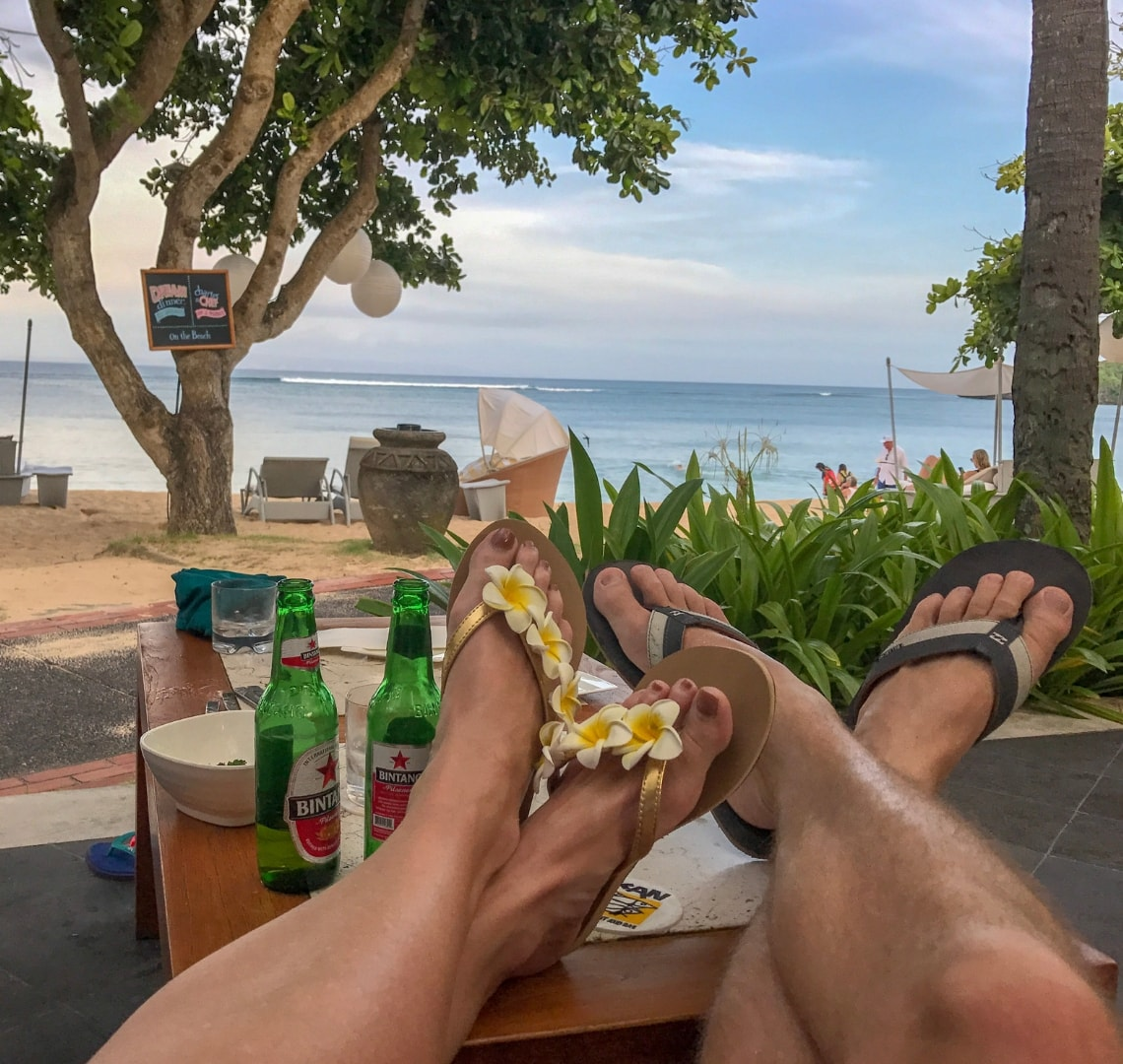 Nusa Dua - view of our feet with a couple of beers and a gorgeous view of the sea