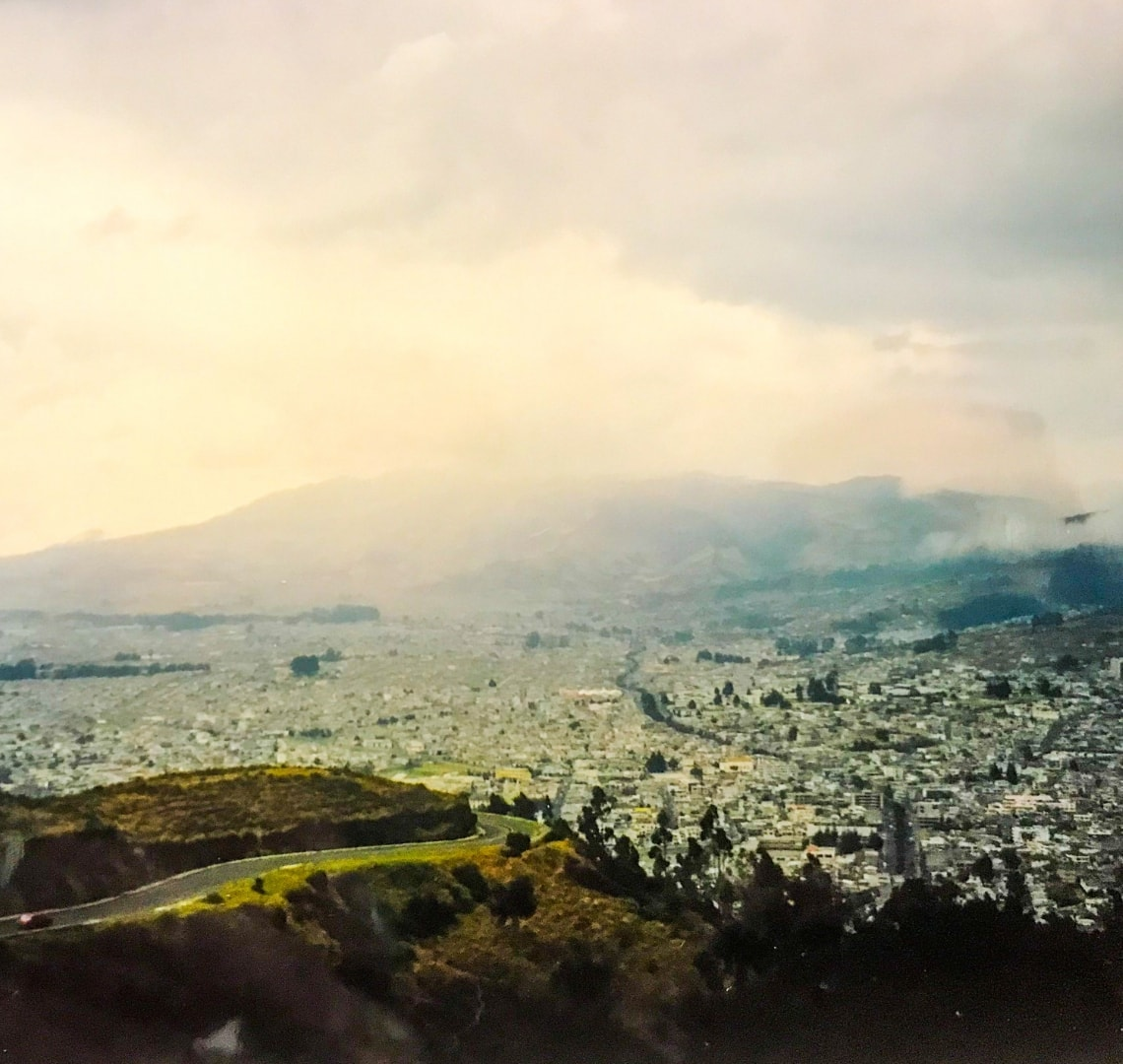 People Who Changed My Life Through Travel - Hillary - view of Quito sprawling below El Panecillo
