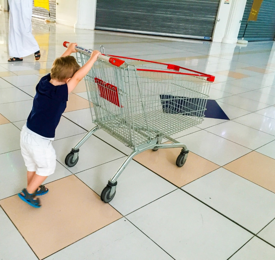 Reasons-To-Travel-Thing-1-pushing-a-shopping-trolley