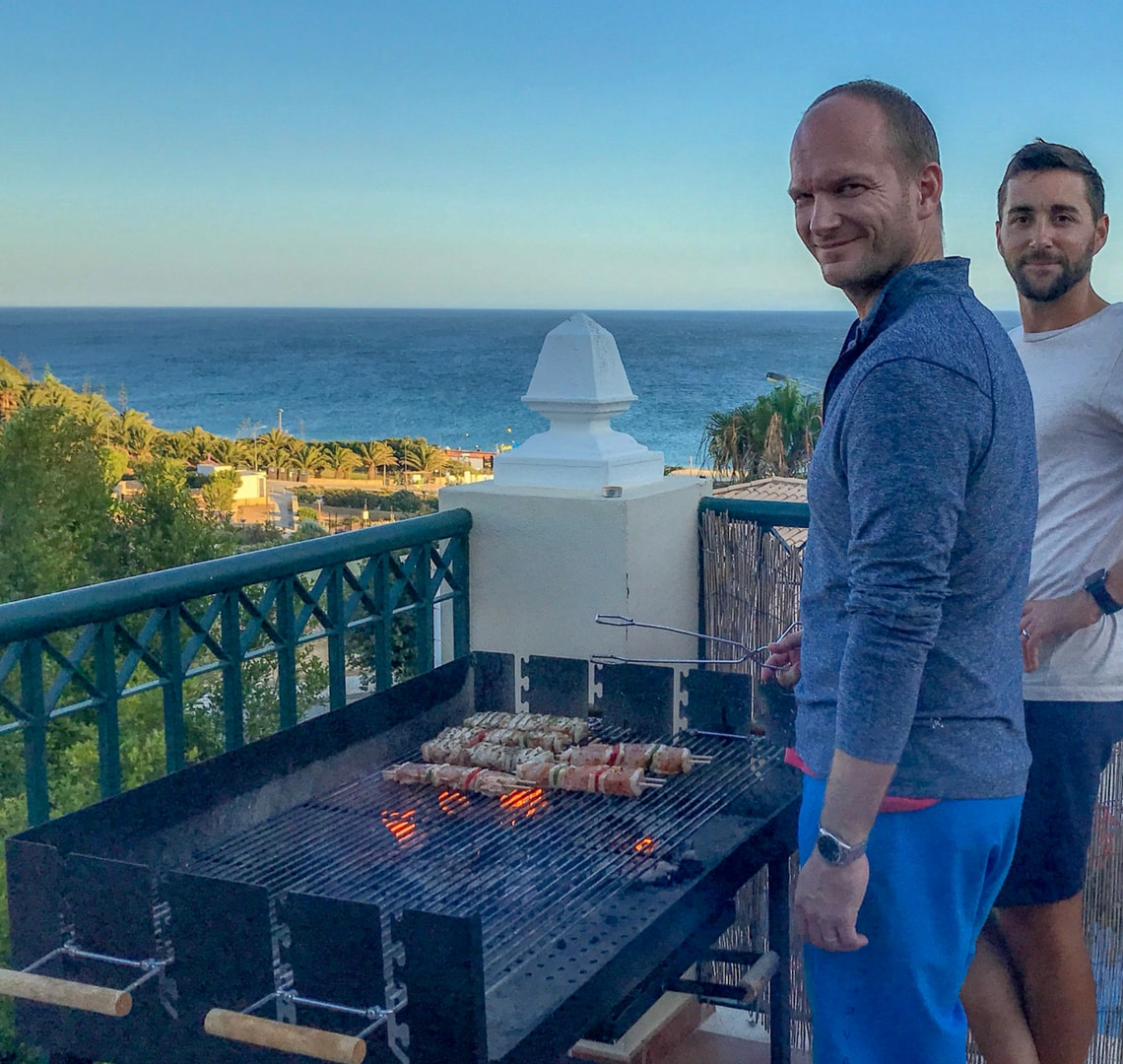 Super fun things to do in Lagos - Mr and Uncle Wanderlust on the BBQ with a stunning evening sea view in the background