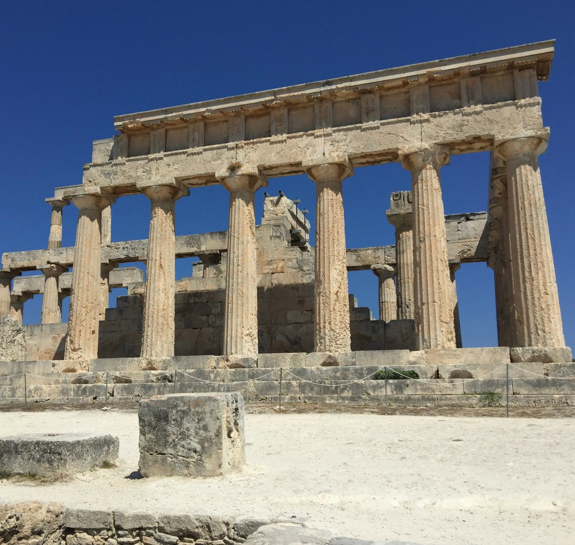 Super fun things to do in Lagos - Ancient Greek ruin against a clear blue sky