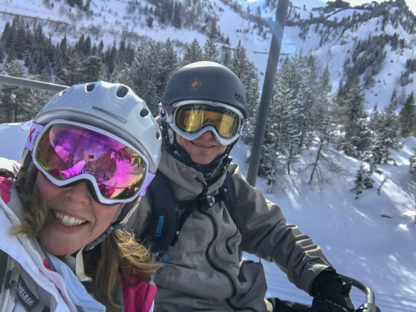 Mr Wanderlust and I on a chairlift in a French ski resort