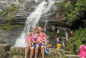 The Wanderlust and Wet Wipes family in front of a waterfall in Kerala - around 24 hours before I asked Mr Wanderlust to get us home early