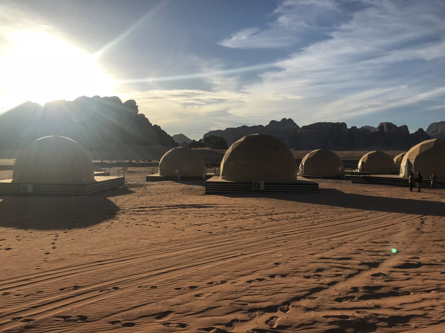 "Jordan Itineraries - Domed ""Martian"" tents surrounded by sandy desert"