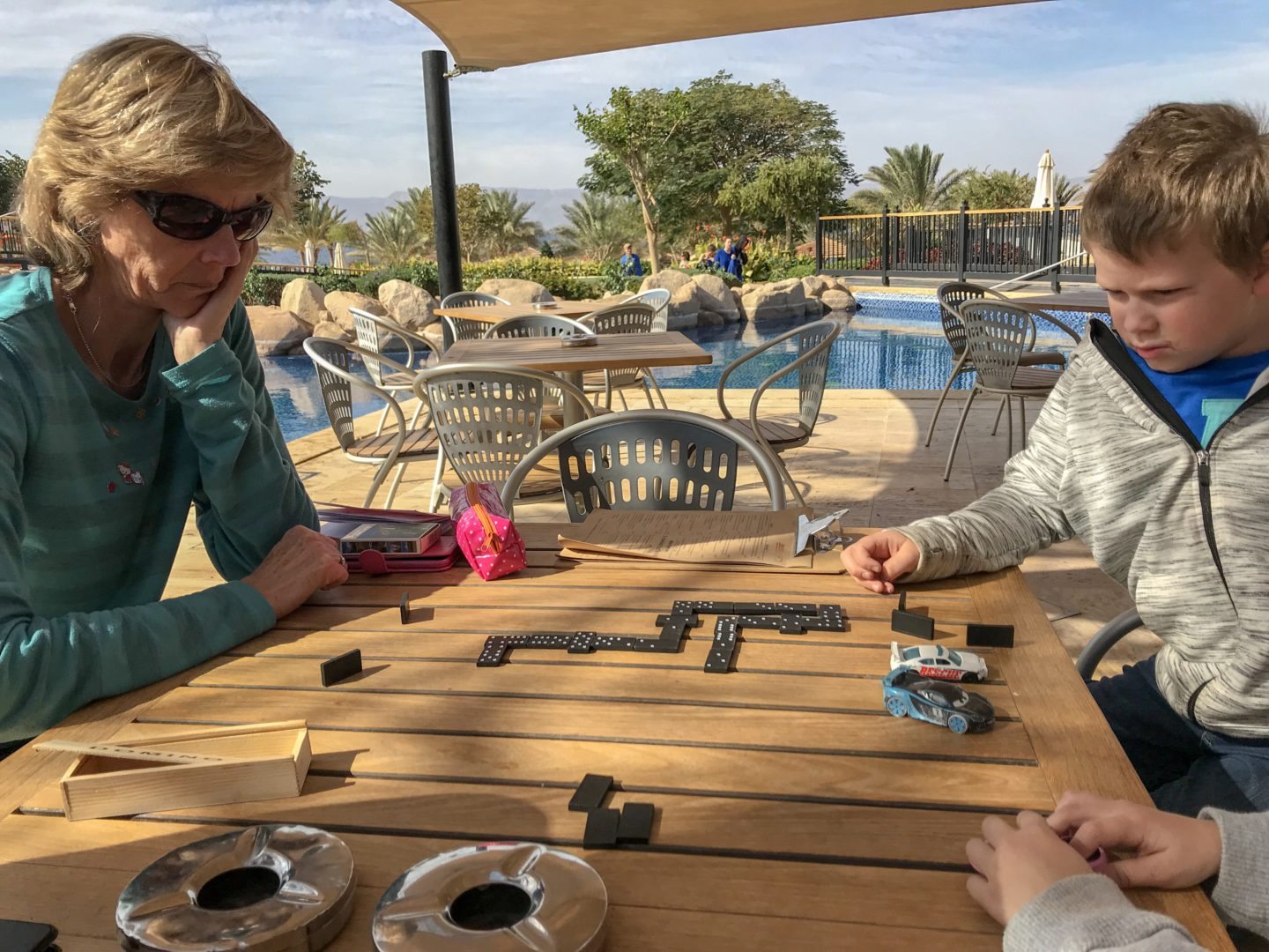 Jordan Adventures Part 5 - Aqaba and the Red Sea - Granny Wanderlust and Thing 1 playing dominoes