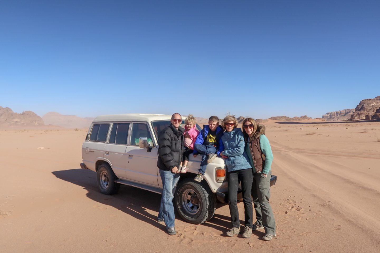 Wanderlust family photos with our Land Cruiser touring jeep - Jordan Adventures Part 4 - Wadi Rum