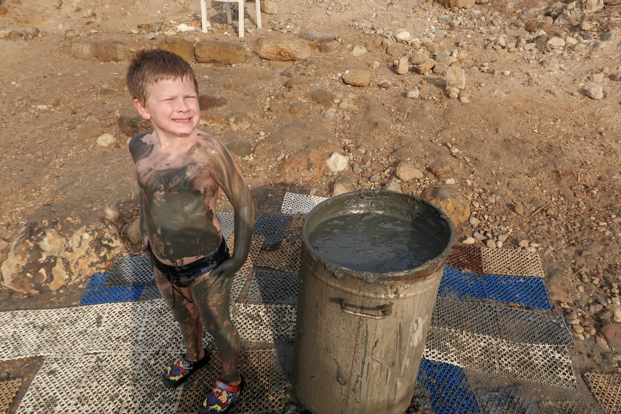 Jordan Adventures Part 2 - the Dead Sea. Thing 1 covered in Dead Sea mud.