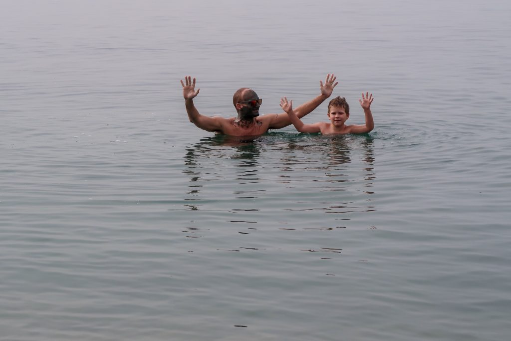 Jordan Itineraries - Mr Wanderlust and Thing 1 floating in the Dead Sea