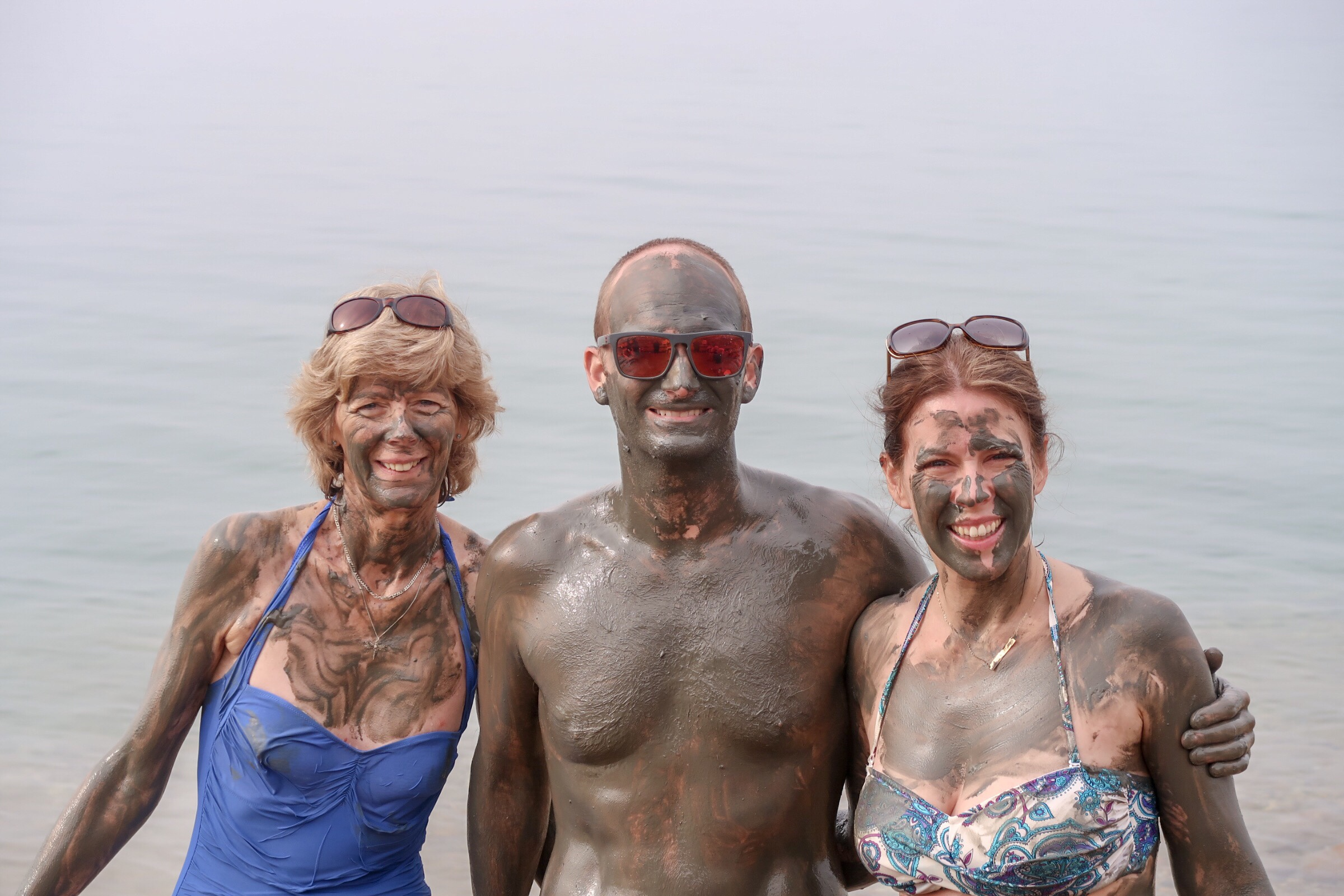 Jordan Adventures Part 2 - the Dead Sea. Granny Wanderlust, Mr Wanderlust and I covered in Dead Sea mud..