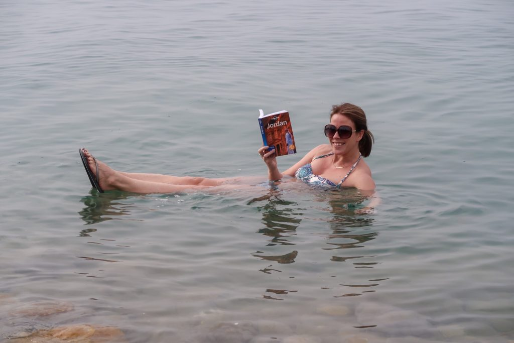 Jordan Itineraries - me in the Dead Sea reading my Lonely Planet