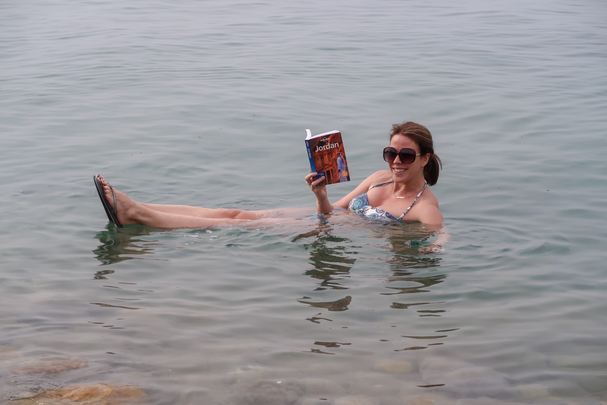Jordan Adventures Part 2 - the Dead Sea. Me reading my Lonely Planet in the Dead Sea