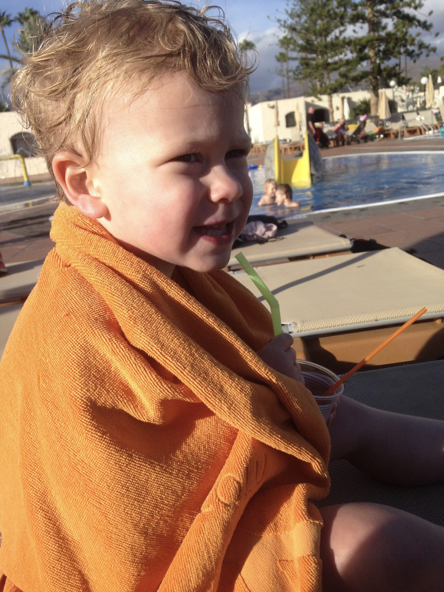 Easy Holidays - Thing 1 wrapped in a towel after a long swim