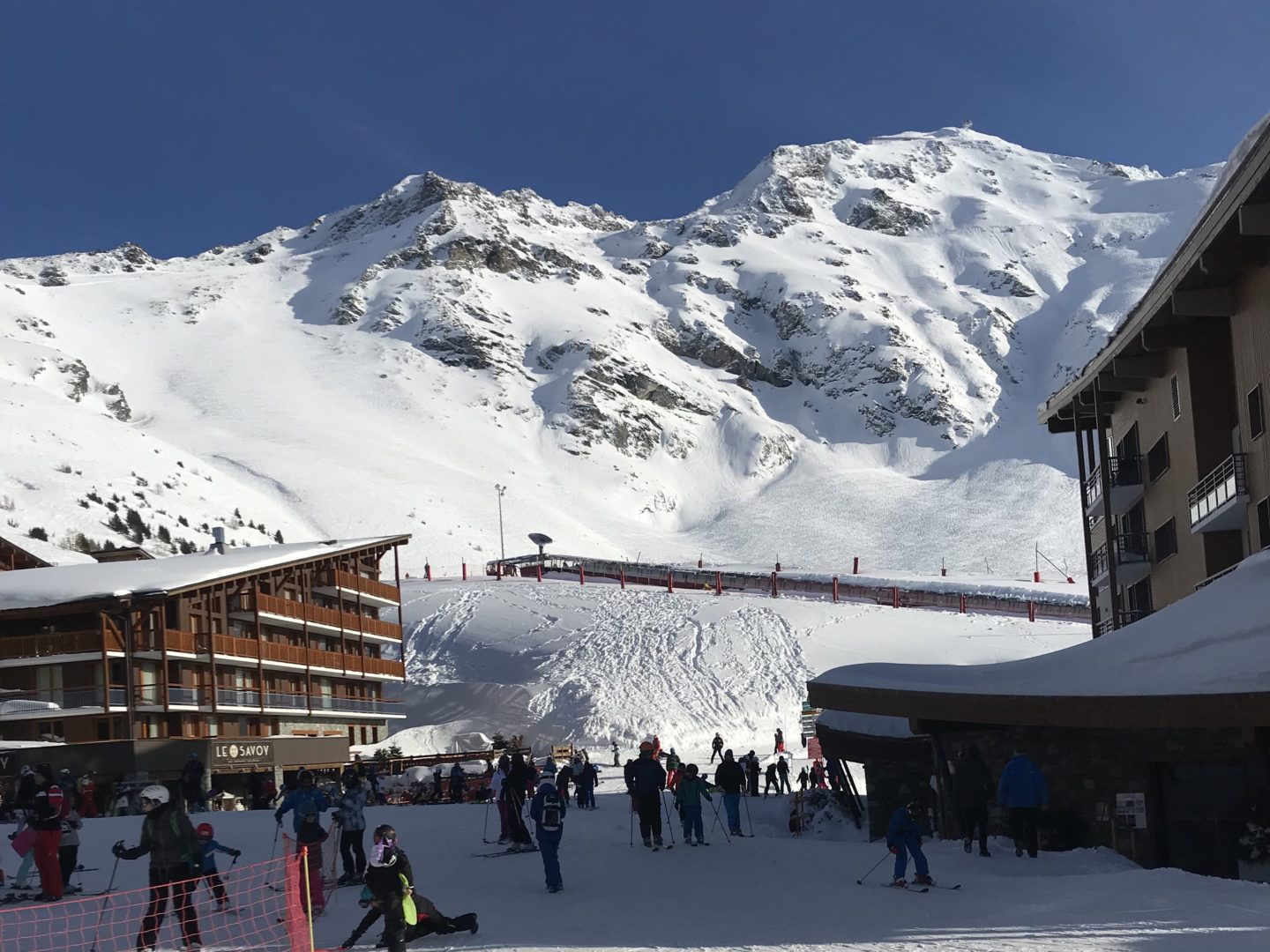 Why You Should Take Your Kids Skiing - View of village with mountains behind