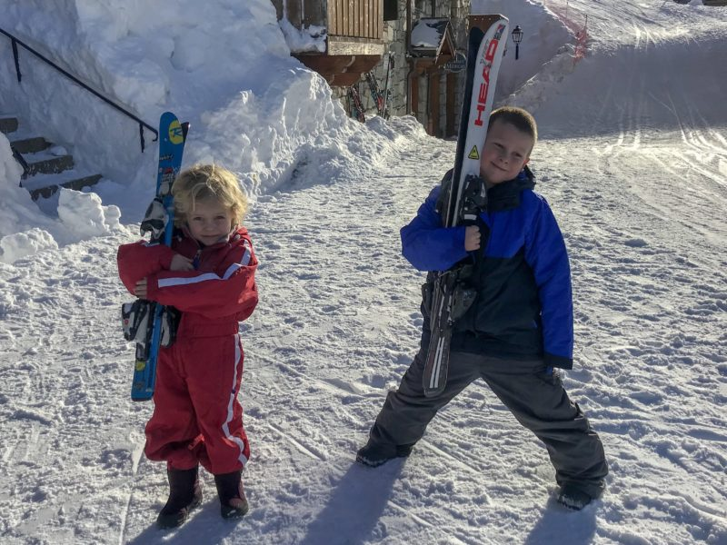 Best Family Ski Holiday - the Things in their ski gear and carrying their skis